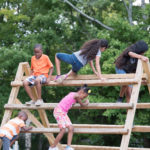 Jesse E. Millis Community Playground with kids in action.