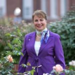 Mariana-Qubein-surrounded-by-flowers