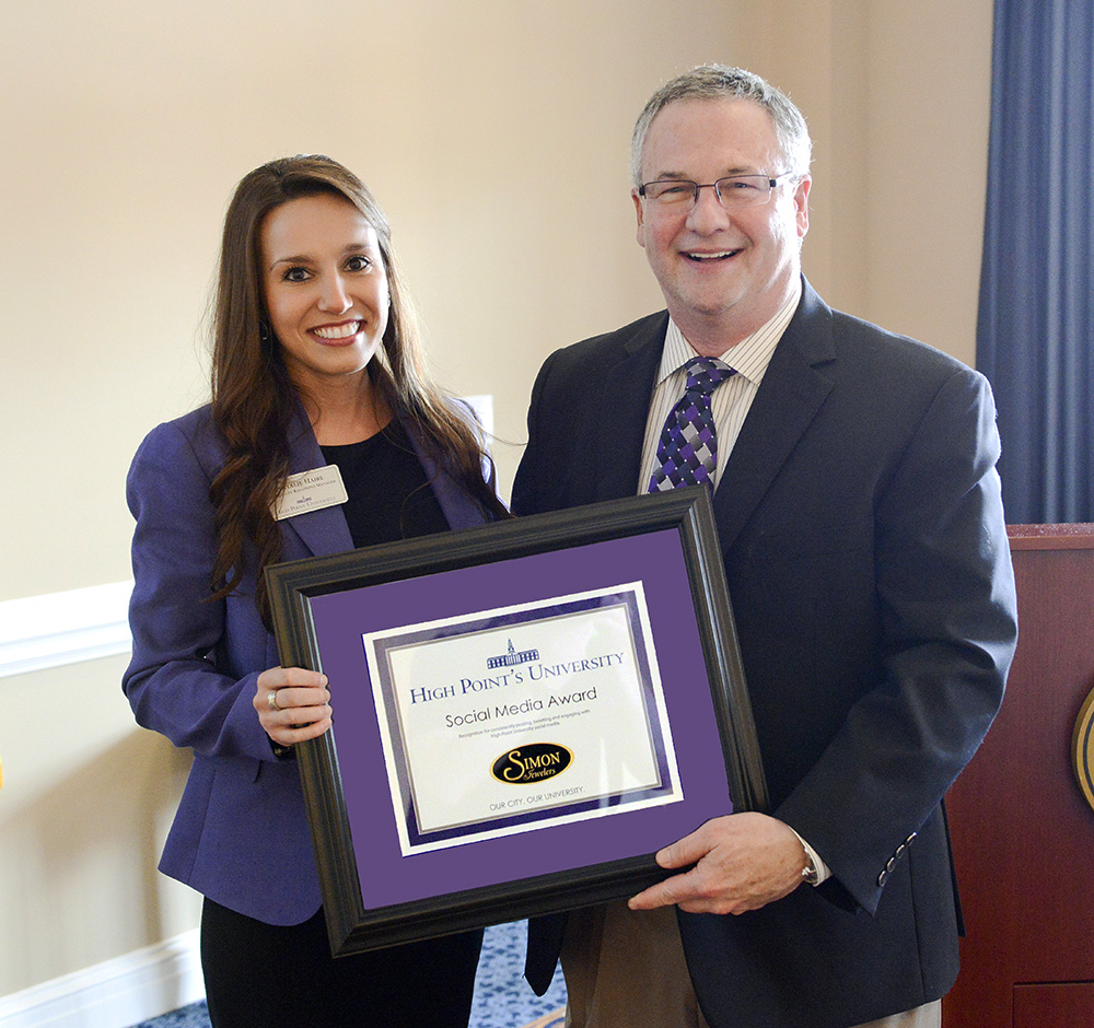 Natalie Haire, community relations manager at High Point University presents  Simon Jewelers with its Social Media award for consistently posting, tweeting and engaging with HPU social media pages.